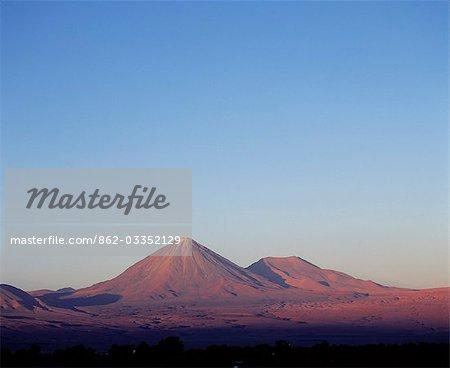 The perfect cone of Volcan Licancabur 5916 m,a sacred mountain to the Atacamenan people,rises above San Pedro de Atacama in the Atacama Desert.