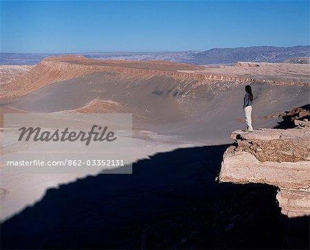 A tourist looks out over the Atacama Desert from Las Cornicas ridge.