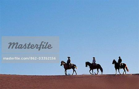 Chile,Atacama Desert. Horse riding in the Atacama desert.