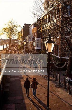 England,London. Walking beside the River Thames near to Hammersmith Bridge.