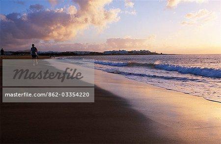 Joggers run along the beach at Playa Matagorda in the early morning