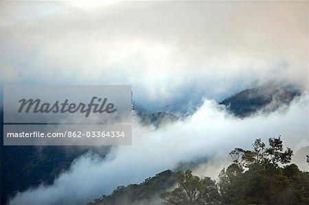 Misty sunrise over Mount Kinabalu National Park,Sabah,Borneo