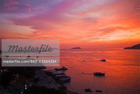 Malaysia,Borneo,Sabah. Dramatic sunset over the South China Sea and the coastal town of Kota Kinabalu.