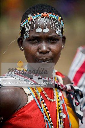 Kenya,Masai Mara National Reserve. Portrait of a Maasai woman in traditional costume.