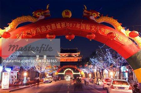 China,Shandong Province,Qufu City. Illuminated City Gate and watch tower - a Unesco World Heritage site