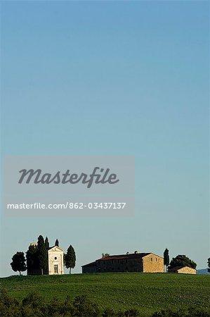 Italy,Tuscany,Val d'Orcia. Chapel of Vitaleta and farmhouse.