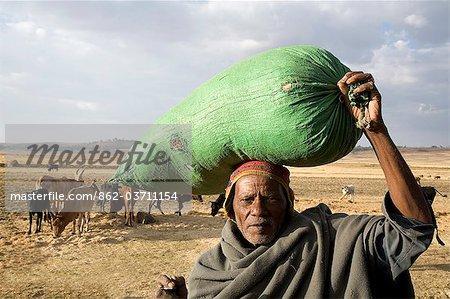 Ethiopia, Debre Markos. An old man with a sack of grain outside Debre Markos.