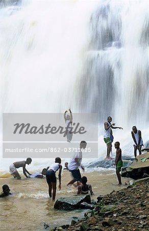 Ghana,Brong Ahafo region,Kintampo. Bathers at Kintampo Falls,one of Ghana's many waterfalls.