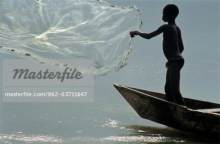Ghana,Volta region,Kpandu. A boy fishing on Lake Volta.