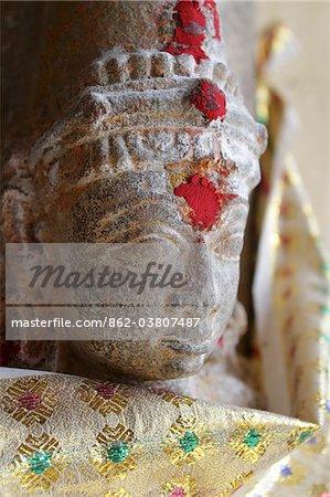 India, Tamil Nadu, Madurai. Deity at a shrine in the Minakshi Sundareshvara Temple.