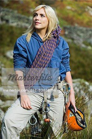 UK, North Wales, Snowdonia.  Woman in climbing harness ready to rock climb.