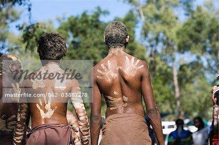 Australia, Queensland, Laura.  Indigenous dancers with handprint decorations on back.