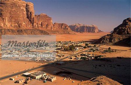 Jordan; Wadi Rum. Spectacular cliffs frame the Bedouin village of Rum, through which most tourists pass when visiting Wadi Rum.
