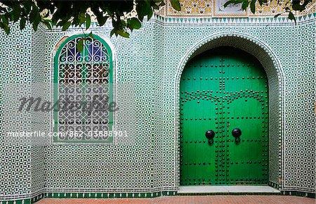 Green facade inside the Chefchaouen medina. Morocco