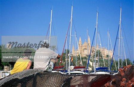 Fishermen in front of the Cathedral  La Seu, Palma de Mallorca, Balearic Islands, Spain