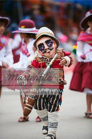 South America, Bolivia, Oruro, Oruro Carnival; Boy in costume