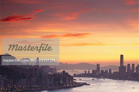 Hong Kong Island and Tsim Sha Tsui skylines at sunset, Hong Kong, China