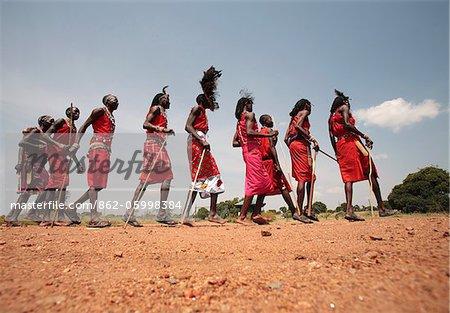 Maasai warriors perform a welcome dance at a lodge in the Masai Mara, Kenya.