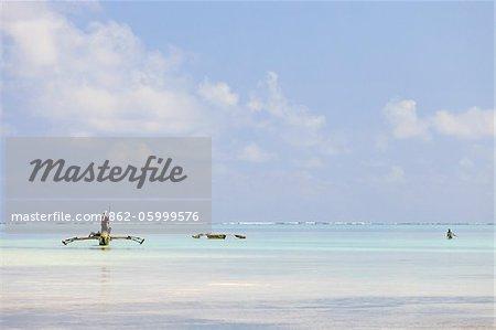 Tanzania, Zanzibar, Unguja Island, Jambiani. Fishermen at low tide.