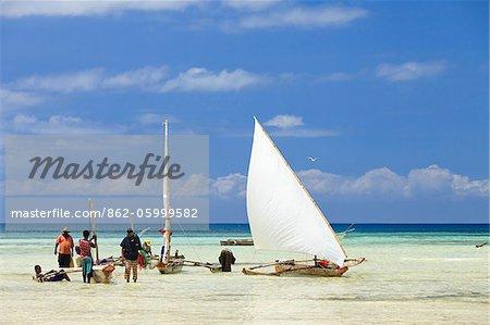 Tanzania, Zanzibar, Unguja Island, Kizimkazi. Fishermen returning with the incoming tide.