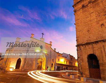 France, Provence, Orange, Eglise Saint Florent at Roman Theatre at dusk