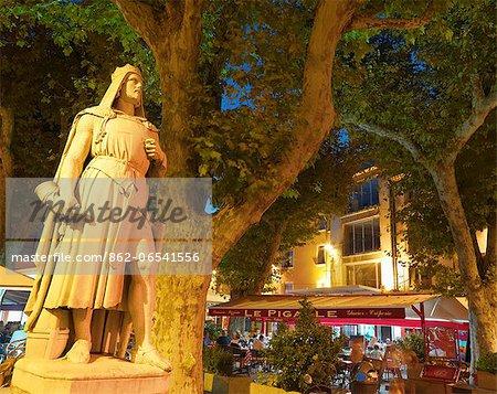 France, Provence, Orange, Place de la Republic, Rimbaud 11 statue at dusk
