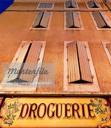 France, Provence, Orange, Droguerie shop front at night