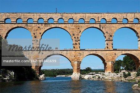 The Pont du Gard is an ancient Roman aqueduct bridge that crosses the Gardon River in southern France.