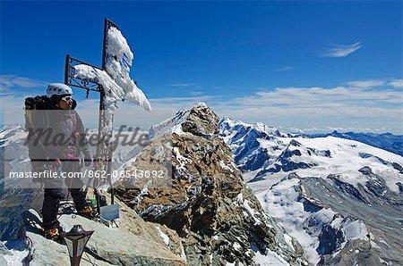 Europe, Switzerland, Swiss Alps, Valais, Zermatt, cross and climber on summit of The Matterhorn , 4478m, MR,