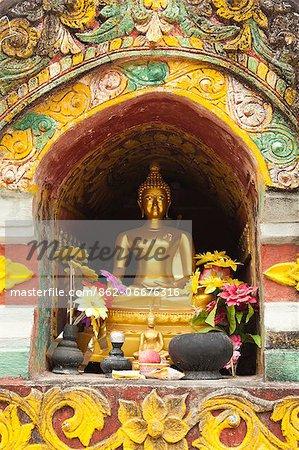 China, Yunnan, Xishuangbanna. A gilded Buddha at the Damenglong Pagodas.