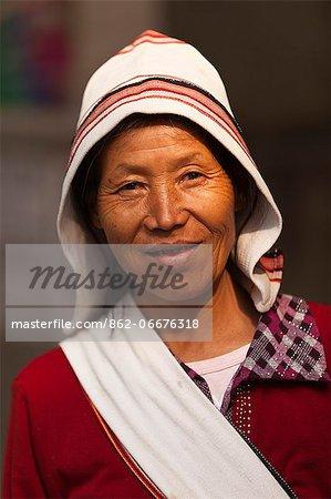 China, Yunnan, Xishuangbanna. A lady of the Jinuo ethnic minority group, wearing the distinctive Dutch-style hat, near Jinghong.