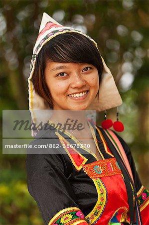 China, Yunnan, Xishuangbanna. A pretty girl of the Jinuo ethnic minority near Jinghong.