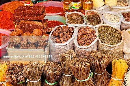 China, Yunnan, Jinghong. Sugar, spices and rice noodles for sale at Jinghong market.
