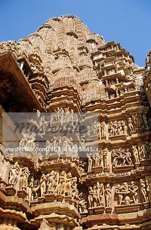 Asia, India, Madhya Pradesh, Khajuraho. Kandariya Mahadev temple, detail of erotic sculptures adorning the exterior.