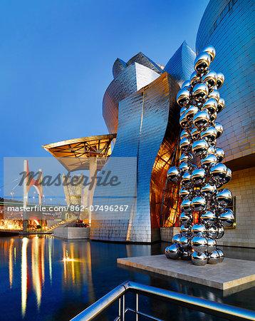 Spain, Bilbao, Guggenheim museum at dusk.