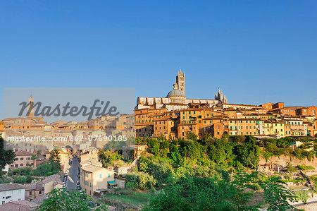 Italy, Tuscany, Siena district, Siena. Torre del Mangia and Santa Maria Assunta Cathedral.