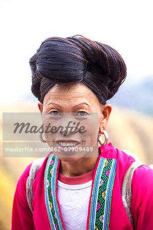 Longsheng (Longji) rice terraces near Guilin, Guanxi, China. Portrait of Yao ethnic minority woman (MR)
