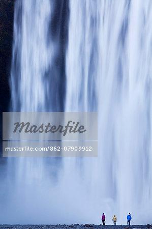 Iceland, Skogafoss. The 62m high waterfall of Skogafoss topples over a rocky cliff at the western edge of Skogar.