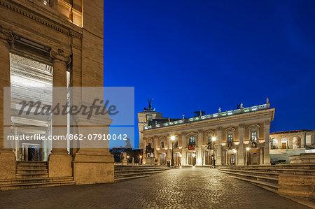 The Piazza del Campidoglio at twilight with the Capotoline Museum inforeground and background, Rome, Lazio, Italy.