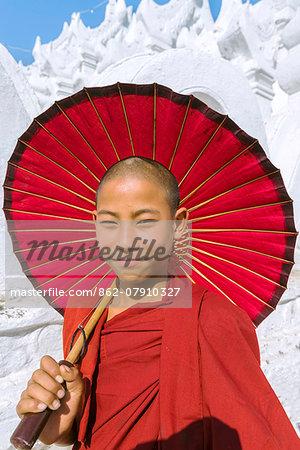 Myanmar, Mandalay division, Mingun. Portrait of young novice monk on Hsinbyume Pagoda (MR)