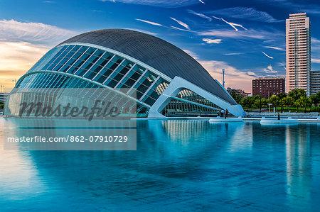 Sunset view of the l'Hemisferic Planetarium and Imax Cinema, located in the City of Arts and Sciences, Ciutata de les Arts i les Ciencies, Valencia, Spain.