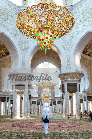 United Arab Emirates, Abu Dhabi. Arabic man inside Sheikh Zayed Grand Mosque