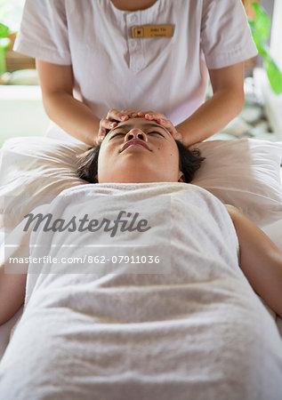 Woman receiving massage in Pilgrimage Village hotel, Hue, Thua Thien-Hue, Vietnam (MR)