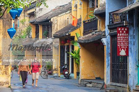 Tourists walking along street, Hoi An (UNESCO World Heritage Site), Quang Ham, Vietnam