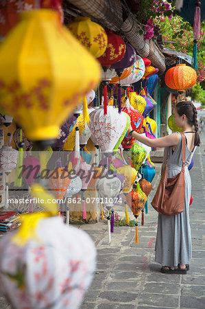 Woman looking at lanterns, Hoi An (UNESCO World Heritage Site), Quang Ham, Vietnam (MR)