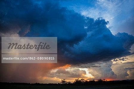 Africa, Kenya, Narok County, Masai Mara National Reserve. Stormy skys across the mara.