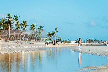 South East Asia, Philippines, The Visayas, Cebu, Bantayan Island, Sugar Beach, girl walking on the beach (MR)