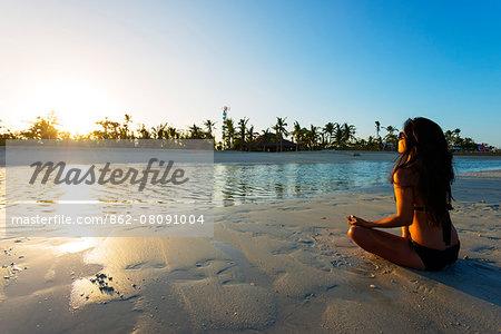 South East Asia, Philippines, The Visayas, Cebu, Bantayan Island, Sugar Beach, girl doing yoga (MR)