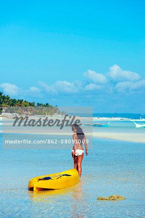 South East Asia, Philippines, The Visayas, Cebu, Bantayan Island, Paradise Beach, girl with a kayak (MR)