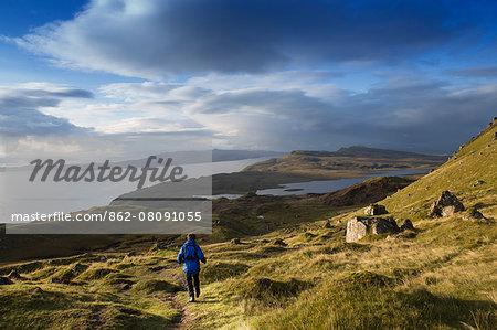 Europe, United Kingdom, Scotland, Skye, Trotternish peninsula, a hiker at the Storr (MR)